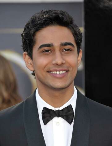 Best: Suraj Sharma does straight-up black tie. Not bad for 19. Photo: John Shearer, Associated Press / Invision
