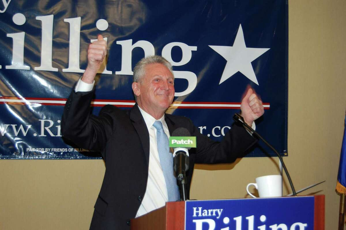 Harry Rilling gives a thumbs up at the conclusion of his speech to announce his bid for mayor of Norwalk, Conn., at the Hilton Garden Inn on Sunday, Feb. 24, 2013.