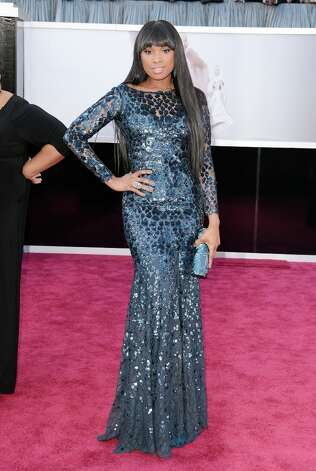 Worst: Jennifer Hudson's dress is too much, her hair too little. Also, don't do the Angelina leg. Photo: Jason Merritt, Getty Images / 2013 Getty Images