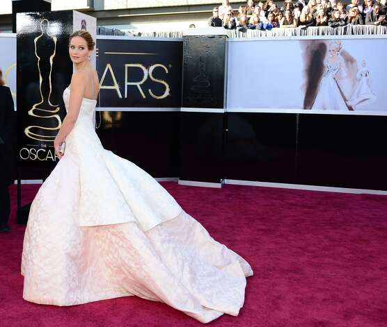 Jennifer Lawrence in a strapless white gown with a tight bodice. Photo: FREDERIC J. BROWN, AFP/Getty Images / AFP