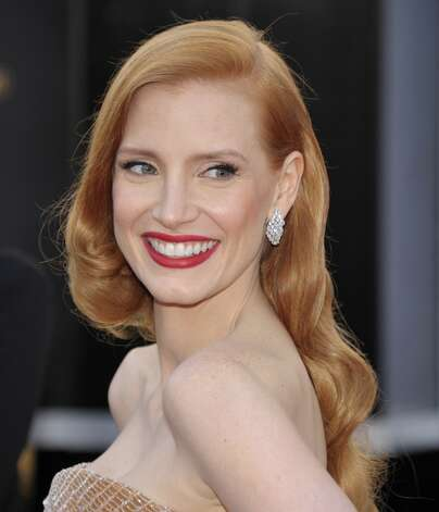 Jessica Chastain arrives at the 85th Academy Awards at the Dolby Theatre on Sunday Feb. 24, 2013, in Los Angeles. (Photo by John Shearer/Invision/AP) Photo: John Shearer, Associated Press / Invision