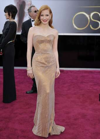 Jessica Chastain in a Giorgio Armani Privé copper-toned silk satin strapless gown. Photo: John Shearer, Associated Press / Invision