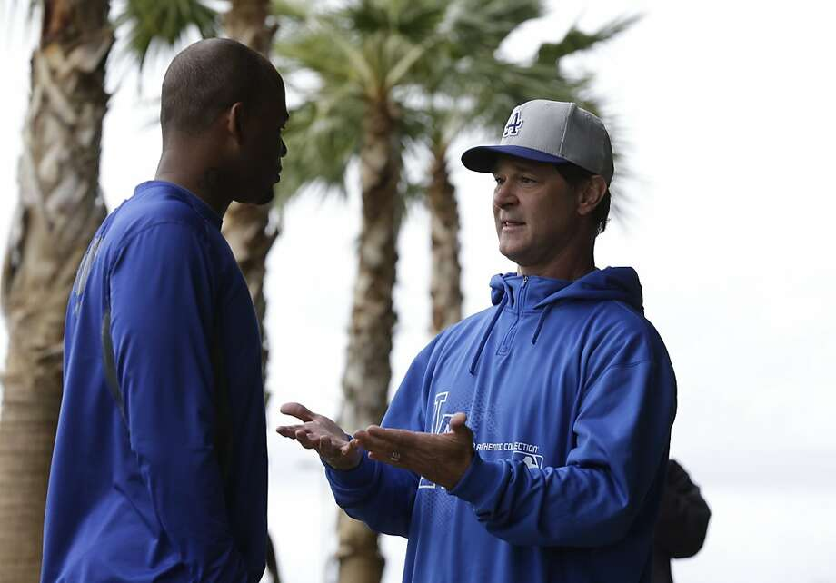 Los Angeles Dodgers manager Don Mattingly, right, talks with outfielder Carl Crawford during spring training baseball in Phoenix, Wednesday, Feb. 20, 2013.  (AP Photo/Paul Sancya) Photo: Paul Sancya, Associated Press