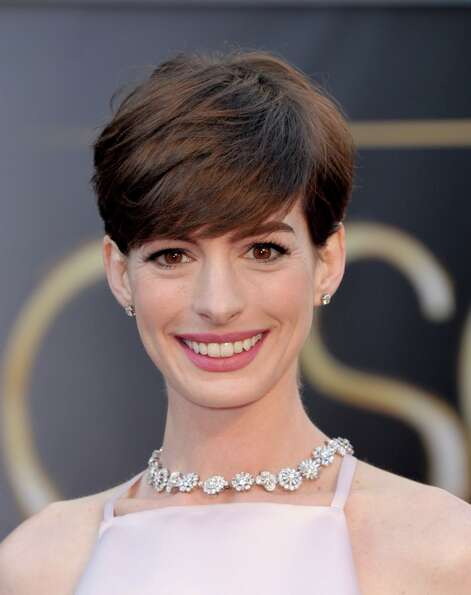 Actress Anne Hathaway arrives at the Oscars at the Dolby Theatre on Sunday Feb. 24, 2013, in Los Ang