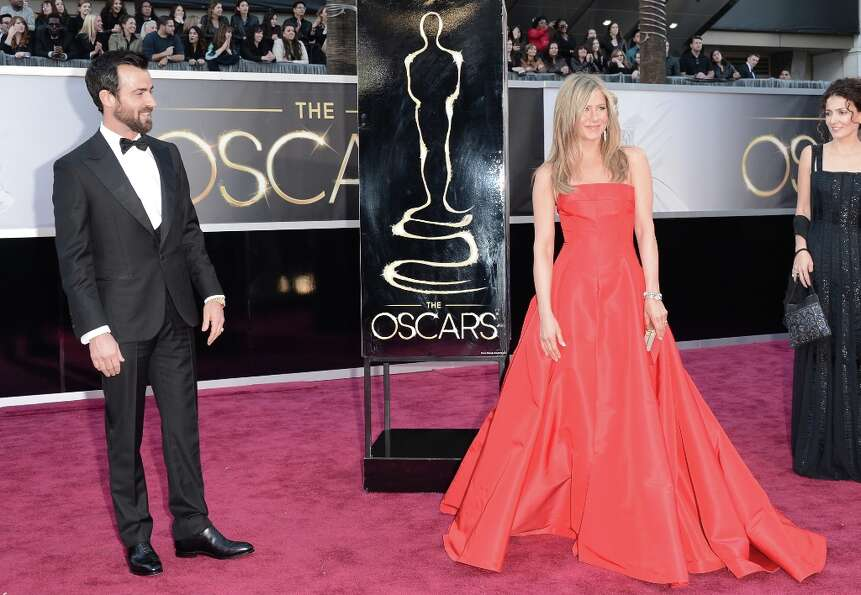 Actors Justin Theroux and Jennifer Aniston arrive at the Oscars at Hollywood & Highland Center on Fe