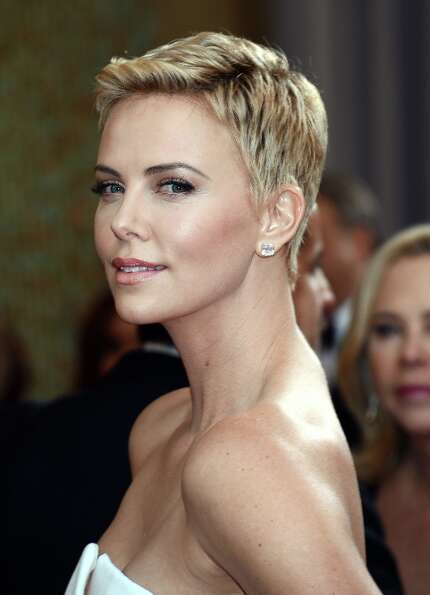 Actress Charlize Theron arrives at the Oscars at Hollywood & Highland Center on February 24, 2013 in