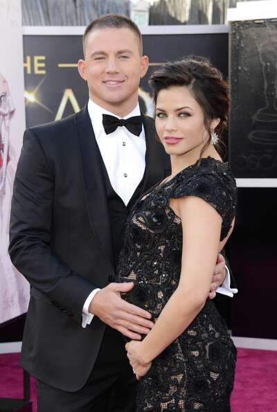 Actors Channing Tatum (L) and Jenna Dewan arrive at the Oscars at Hollywood & Highland Center on Feb