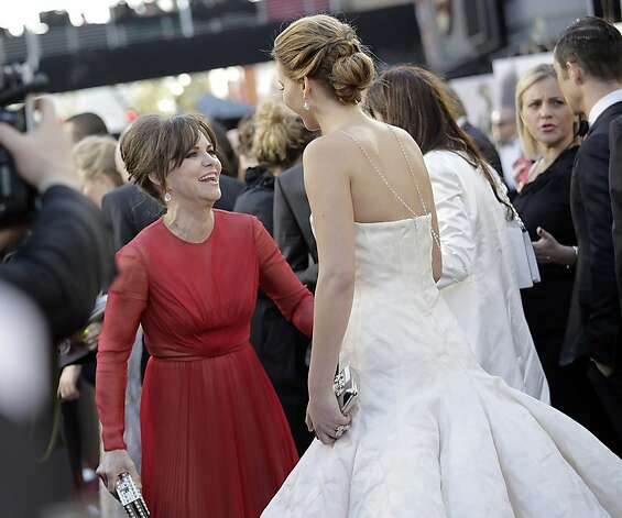 Sally Field, in fuchsia, greets Jennifer Lawrence, in winter white. Photo: Jay L. Clendenin, McClatchy-Tribune News Service