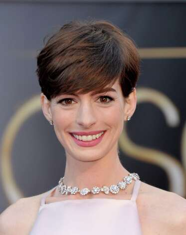 Actress Anne Hathaway arrives at the Oscars at the Dolby Theatre on Sunday Feb. 24, 2013, in Los Angeles. (Photo by John Shearer/Invision/AP) Photo: John Shearer, Associated Press / Invision