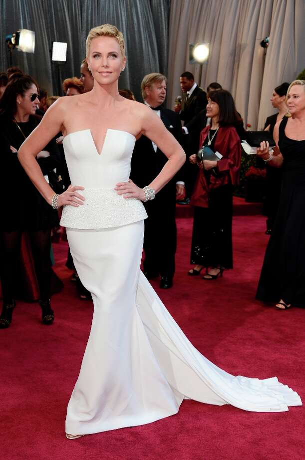 Actress Charlize Theron arrives at the Oscars at Hollywood & Highland Center on February 24, 2013 in Hollywood, California. Photo: Frazer Harrison, Getty Images / 2013 Getty Images
