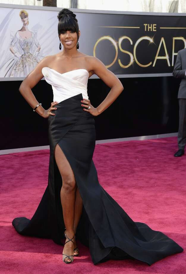 Worst: Kelly Rowland. Homegirl, hmmm. Not sure about the dress, but really sure about your overworking the Angelina leg. Photo: Jason Merritt, Getty Images / 2013 Getty Images