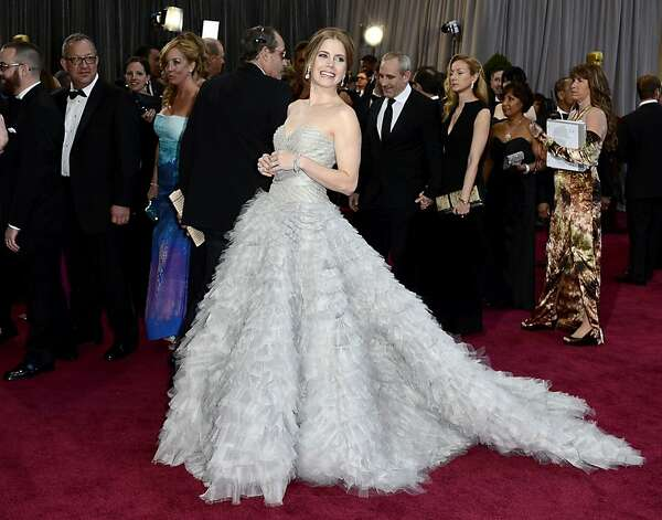 Amy Adams swooped through the crowd in a dramatically fluffy silver-gray de la Renta. Photo: Frazer Harrison, Getty Images