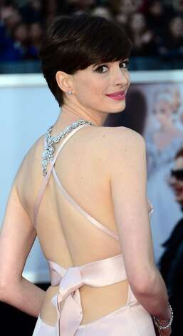 Best Supporting Actress nominee Anne Hathaway arrives on the red carpet for the 85th Annual Academy Awards on February 24, 2013 in Hollywood, California. AFP PHOTO/FREDERIC J. BROWN Photo: FREDERIC J. BROWN, AFP/Getty Images / AFP