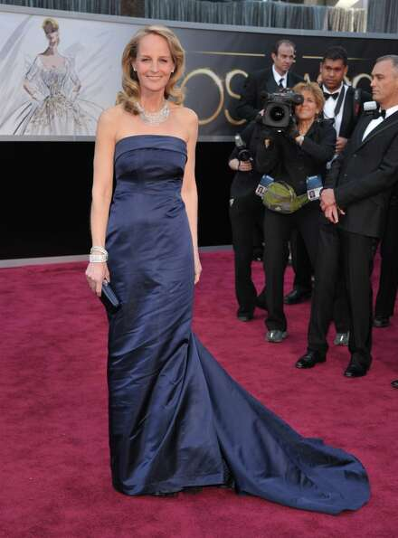 Actress Helen Hunt arrives at the Oscars at the Dolby Theatre on Sunday Feb. 24, 2013, in Los Angele