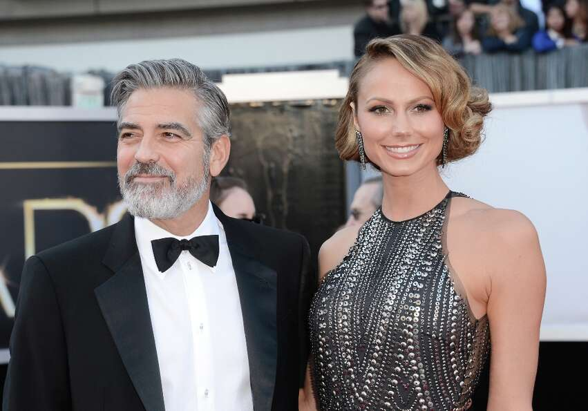 Actors George Clooney and Stacy Keibler arrive at the Oscars at Hollywood & Highland Center on Febru