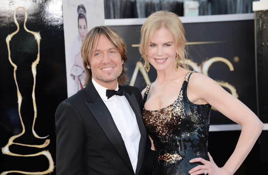Singer Keith Urban and actress Nicole Kidman arrive at the Oscars at Hollywood & Highland Center on