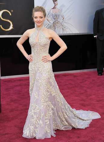 Amanda Seyfried wore a pale halter style with a gracefully swirling hem. Photo: John Shearer, Associated Press