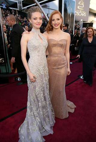 HOLLYWOOD, CA - FEBRUARY 24:  Actresses Amanda Seyfried (L) and Jessica Chastain arrive at the Oscars held at Hollywood & Highland Center on February 24, 2013 in Hollywood, California.  (Photo by Christopher Polk/Getty Images) Photo: Christopher Polk, Getty Images