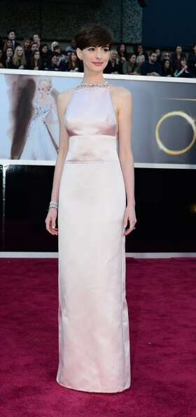Best Supporting Actress nominee Anne Hathaway arrives on the red carpet for the 85th Annual Academy