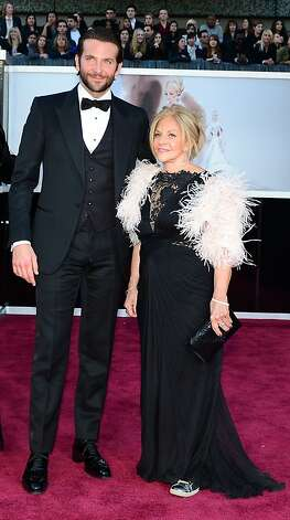 Best Actor nominee Bradley Cooper and guest arrive on the red carpet for the 85th Annual Academy Awards on February 24, 2013 in Hollywood, California. AFP PHOTO/FREDERIC J. BROWNFREDERIC J. BROWN/AFP/Getty Images Photo: Frederic J. Brown, AFP/Getty Images