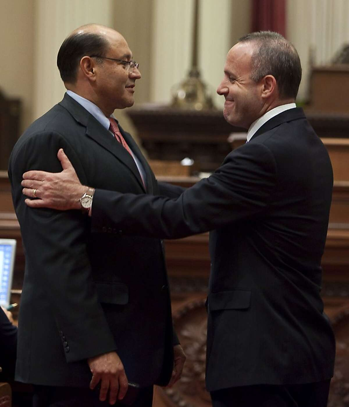 Darrell Steinberg (D-Sacramento), right, president pro tem of the Senate,greets Senator Lou Correa (D- Santa Ana) left, early in the evening before voting began on the 31 bills that make up the budget in Sacramento, July 23, 2009 on the Senate floor.