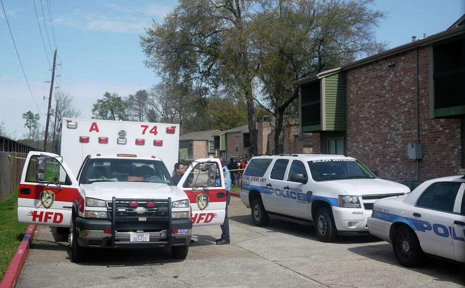Houston police and fire personnel gather at the scene of a north Houston incident where a 4-year-old boy shot and killed himself with his father's handgun. Photo: Minh Dam, Staff / © 2013  Houston Chronicle