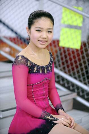 Rina Tsuchiya, 12, of RFSC, watches the 2013 Greenwich Town Figure Skating Competition at the Dorothy Hamill Skating Rink, in Byram, Conn., Sunday, Feb. 24, 2013. Photo: Helen Neafsey / Greenwich Time