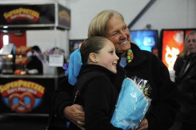 Ashlely Sapiente, 9, gets a hug from her aunt Elaine Coris, of Seymour, during at the 2013 Greenwich Town Figure Skating Competition at the Dorothy Hamill Skating Rink, in Byram, Conn., Sunday, Feb. 24, 2013. Photo: Helen Neafsey / Greenwich Time