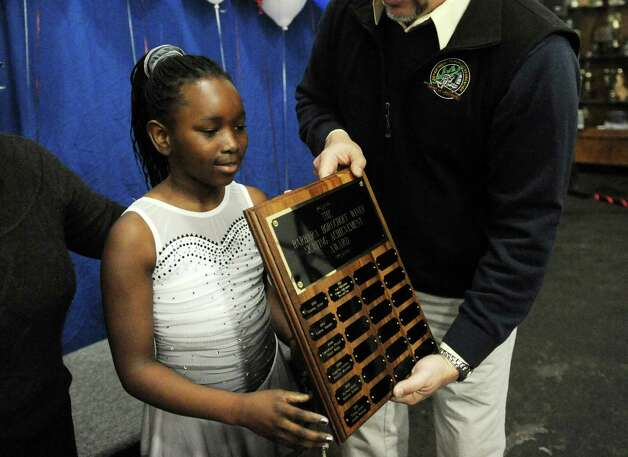 Sherlynn Arcuri, 9, receive an award at the 2013 Greenwich Town Figure Skating Competition at the Dorothy Hamill Skating Rink, in Byram, Conn., Sunday, Feb. 24, 2013. Photo: Helen Neafsey / Greenwich Time