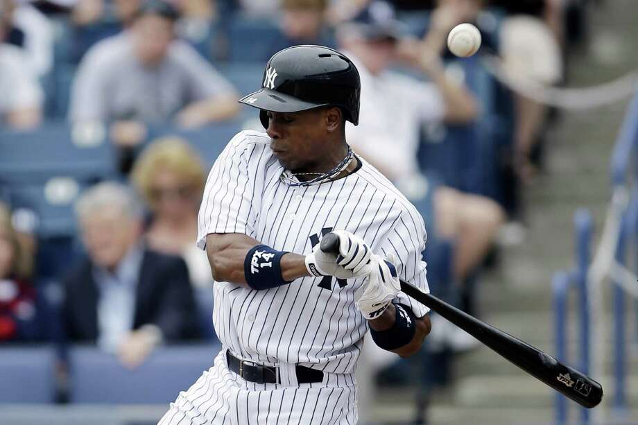 New York Yankees' Curtis Granderson is hit by a pitch from the Toronto Blue Jays' J.A. Happ during the first inning of a spring training exhibition baseball game, Sunday, Feb. 24, 2013, in Tampa, Fla. Granderson left the game after the play. (AP Photo/Matt Slocum) Photo: Matt Slocum