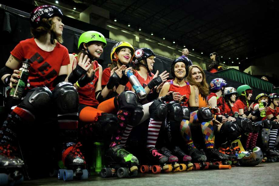Members of the Tilted Thunder Peeps team warm up with a singalong before the season opener of the Banked Track Roller Derby, presented by the Tilted Thunder Rail Birds, on Sunday, Feb. 24, 2013, at Comcast Arena in Everett, Wash. Four teams - the Saint Hellions, the Sugar Skulls,