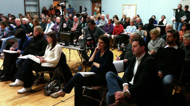 More than 100 people attended a Wednesday night forum sponsored by the town on issues of repairs and reconstruction in the aftermath of Superstorm Sandy.  FAIRFIELD CITIZEN, CT 2/20/13 Photo: Andrew Brophy / Fairfield Citizen contributed