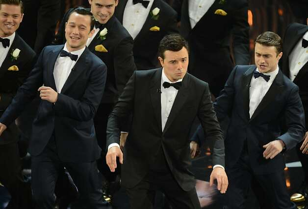 Joseph Gordon-Levitt (second from left), Seth MacFarlane and Daniel Radcliffe in a song-and-dance act. Photo: Robyn Beck, AFP/Getty Images