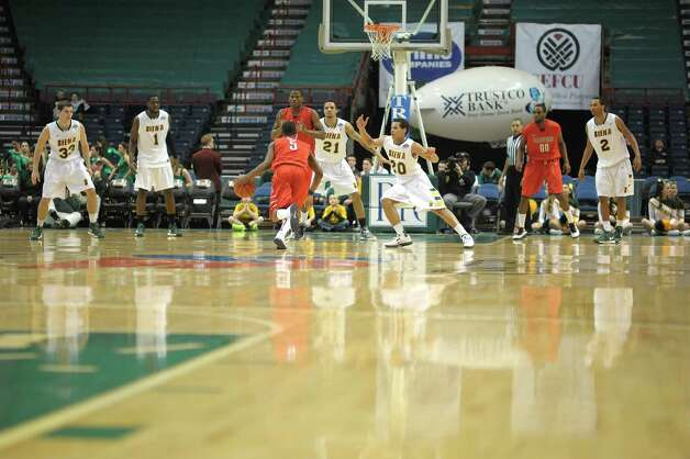 Siena players try to stop Radford from scoring during their game at the Times Union Center on Sunday, Feb. 24, 2013 in Albany, NY.  (Paul Buckowski / Times Union) Photo: Paul Buckowski  / 00021251A