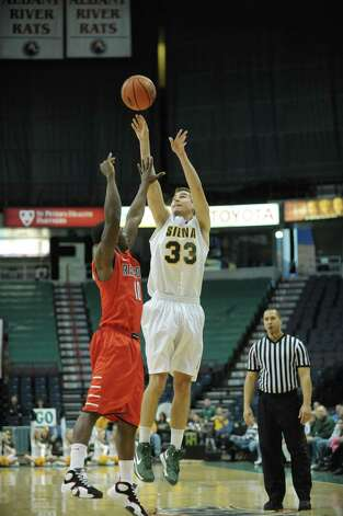 Rob Poole of Siena, right, puts up a shot over a  Radford defender during their game at the Times Union Center on Sunday, Feb. 24, 2013 in Albany, NY.  (Paul Buckowski / Times Union) Photo: Paul Buckowski  / 00021251A