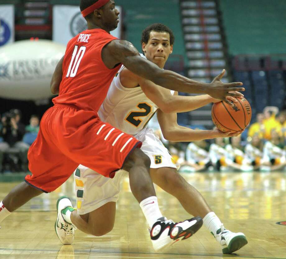 Chris Leppanen of Siena, right, looks to make a pass around R.J. Price of Radford during their game at the Times Union Center on Sunday, Feb. 24, 2013 in Albany, NY.  (Paul Buckowski / Times Union) Photo: Paul Buckowski  / 00021251A