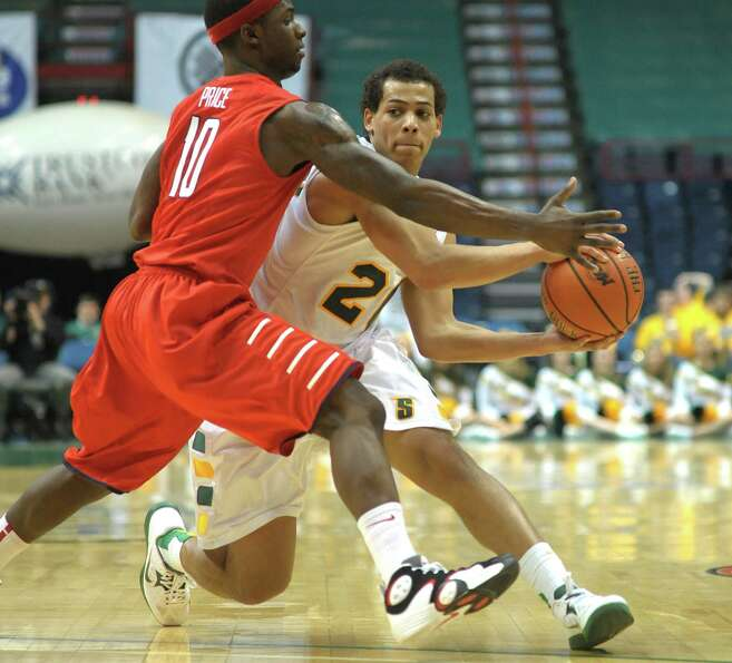 Chris Leppanen of Siena, right, looks to make a pass around R.J. Price of Radford during their game