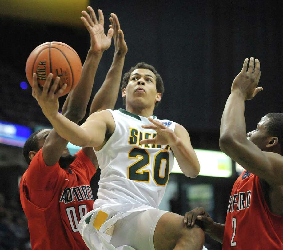 Chris Leppanen of Siena, center, cuts through two Radford defenders as he drives towards the basket during their game at the Times Union Center on Sunday, Feb. 24, 2013 in Albany, NY.  (Paul Buckowski / Times Union) Photo: Paul Buckowski  / 00021251A