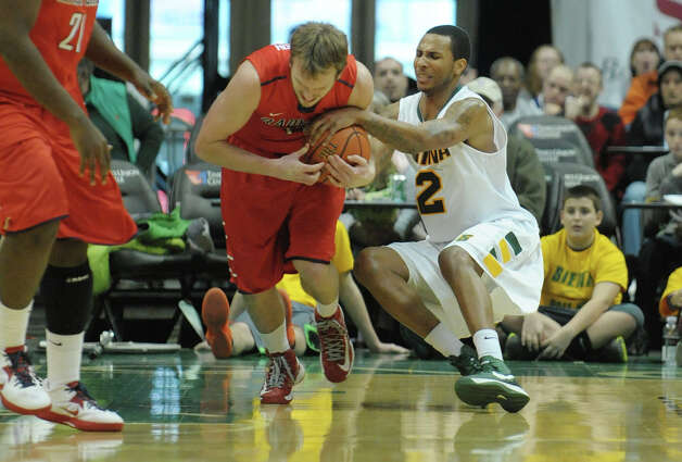 Trenity Burdine of Siena, right, tries to steal the ball from Allen Dickerson of Radford during their game at the Times Union Center on Sunday, Feb. 24, 2013 in Albany, NY.  (Paul Buckowski / Times Union) Photo: Paul Buckowski  / 00021251A
