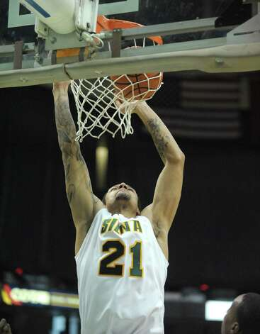 Davis Martens of Siena, goes up for a dunk  during their game against Radford at the Times Union Center on Sunday, Feb. 24, 2013 in Albany, NY.  (Paul Buckowski / Times Union) Photo: Paul Buckowski  / 00021251A
