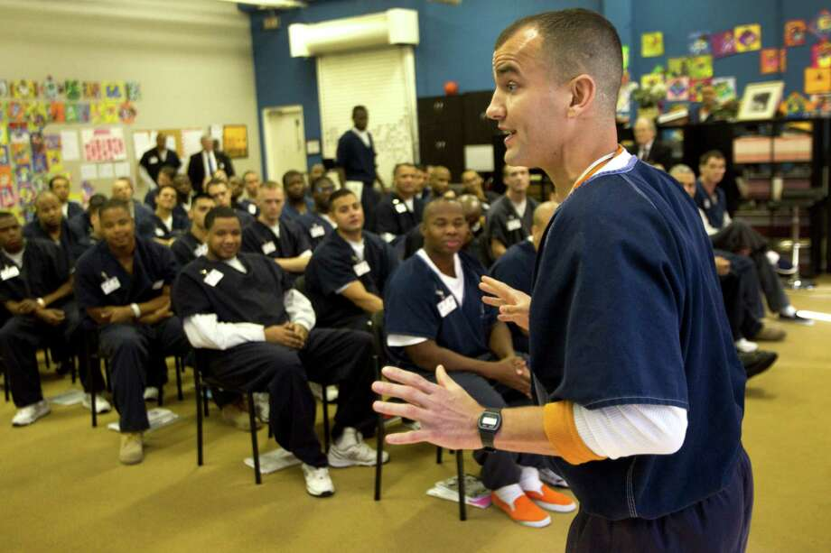 Morgan Crocker presents his business plan in a Prison Entrepreneurship Program class at the Cleveland Correctional Center. Photo: Brett Coomer, Staff / © 2013 Houston Chronicle