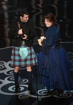 Co-directors Mark Andrews and Brenda Chapman accept the Best Animated Feature Film award for Brave onstage during the Oscars held at the Dolby Theatre on February 24, 2013 in Hollywood, California. Photo: Kevin Winter, Getty Images / 2013 Getty Images