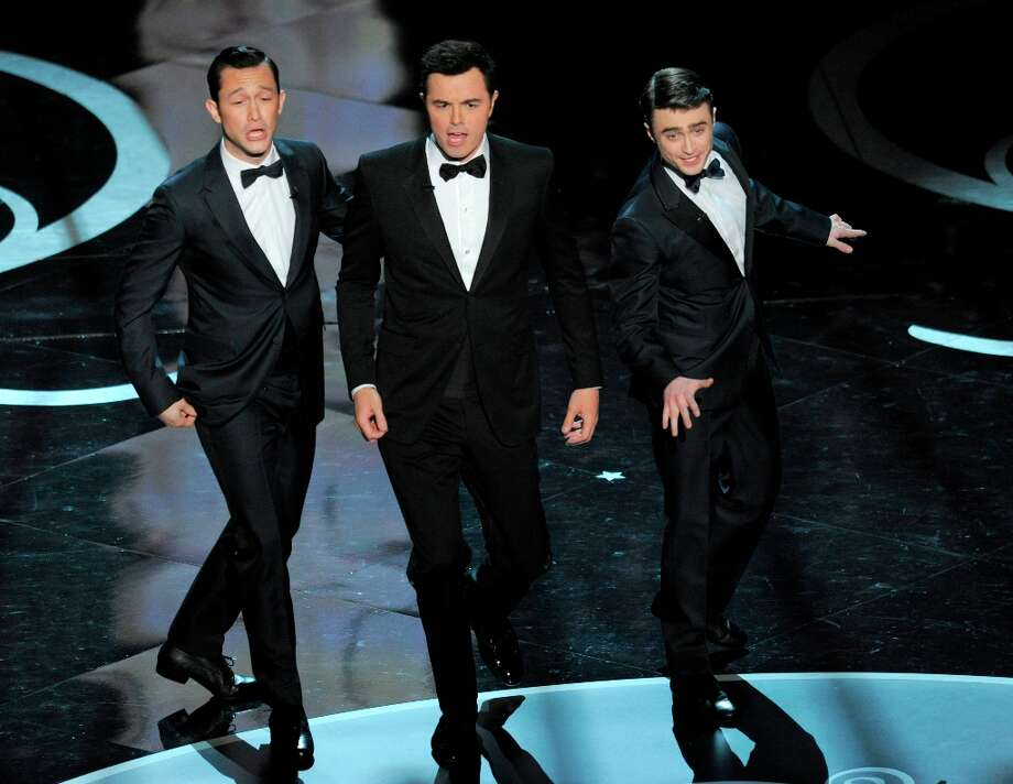 Actors, from left, Joseph Gordon-Levitt, host Seth MacFarlane and Daniel Radcliffe perform during the Oscars at the Dolby Theatre on Sunday Feb. 24, 2013, in Los Angeles.  (Photo by Chris Pizzello/Invision/AP) Photo: Chris Pizzello, Associated Press / Invision
