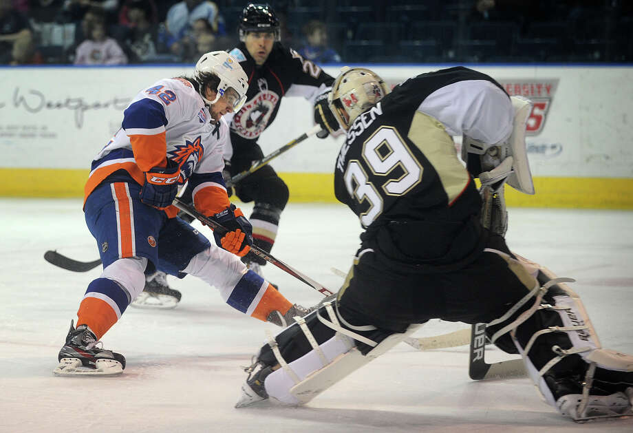 Sound Tiger Brandon DeFazio looks to score against Wilkes-Barre/Scranton goalie Brad Thiessen in the first period of their AHL matchup at the Webster Bank Arena in Bridgeport on Sunday, February 24, 2013. Photo: Brian A. Pounds