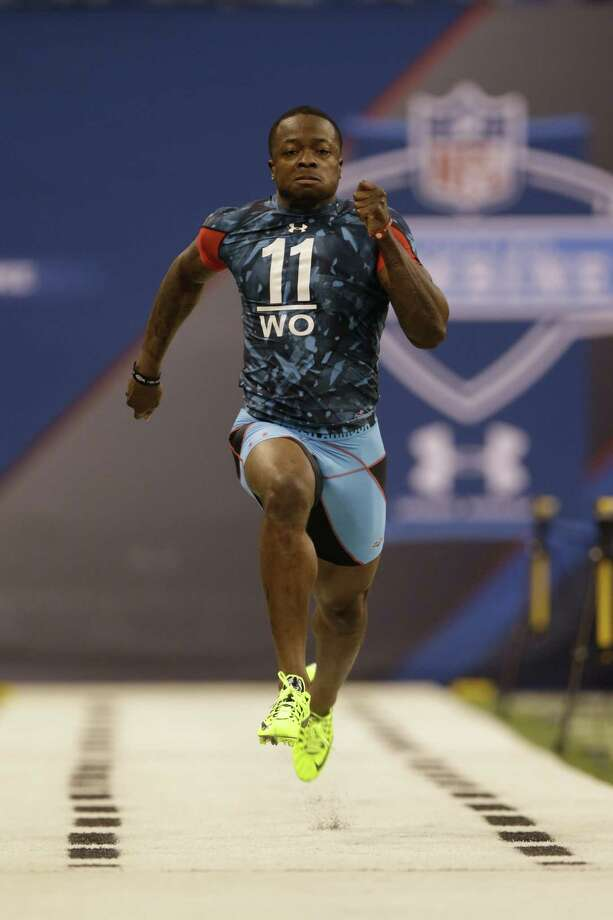 Texas wide receiver Marquise Goodwin runs a 4.27-second 40-yard dash Sunday at the NFL combine in Indianapolis. Photo: Michael Conroy / Associated Press