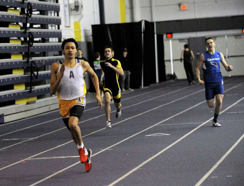 Izaiah Brown of Amsterdam High School wins the Boys 300 Meter Race during the State Indoor Track Qua