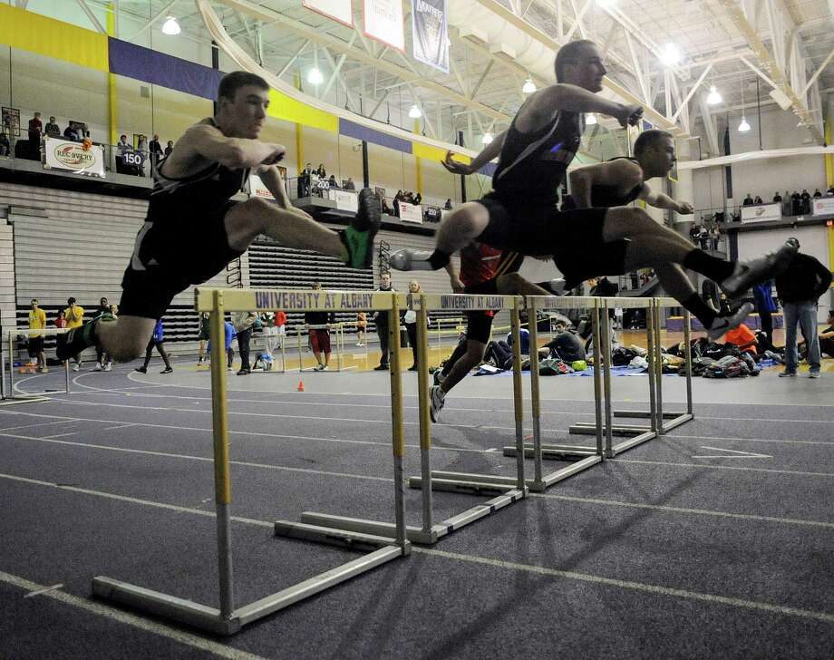 Hurdlers compete during the Boys 55 Meter High Hurdle semi final race of the State Indoor Track Qualifier at the SEFCU Arena in Albany, N.Y., Sunday, Feb. 24, 2011. (Hans Pennink / Special to the Times Union) High School Sports Photo: Hans Pennink / Hans Pennink