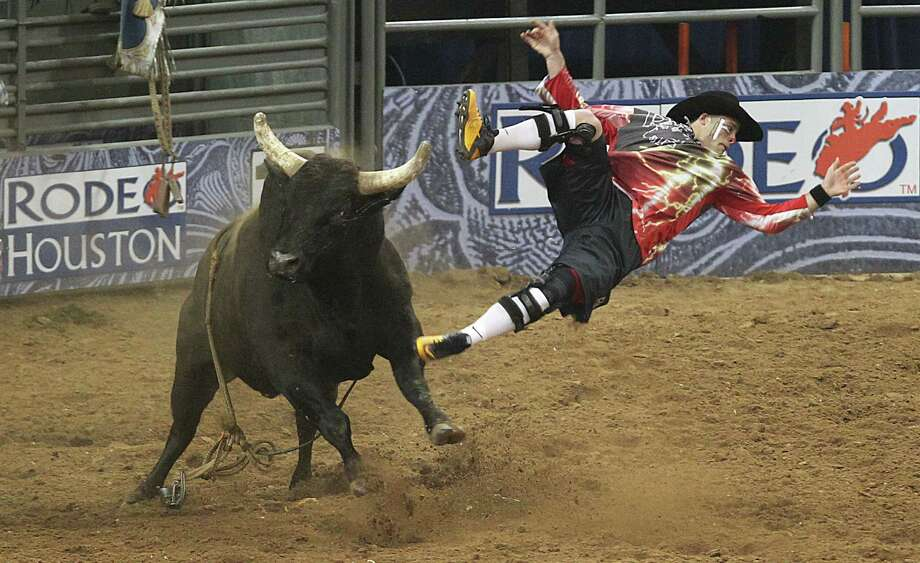 Dusty Tuckness demonstrates the rough and tumble nature of bullfighting during the 2011 version of RodeoHouston. Photo: James Nielsen, Staff / Houston Chronicle