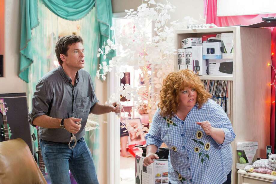"FILE -This undated publicity file image released by Universal Pictures shows Jason Bateman, left, and Melissa McCarthy in a scene from, ""Identity Thief."" As of Sunday, Feb. 24, 2013,  ""Identity Thief"", with a cumulative total of $93.7 million viewers, is the biggest hit so far in 2013. (AP Photo/Universal Pictures) Photo: Uncredited"