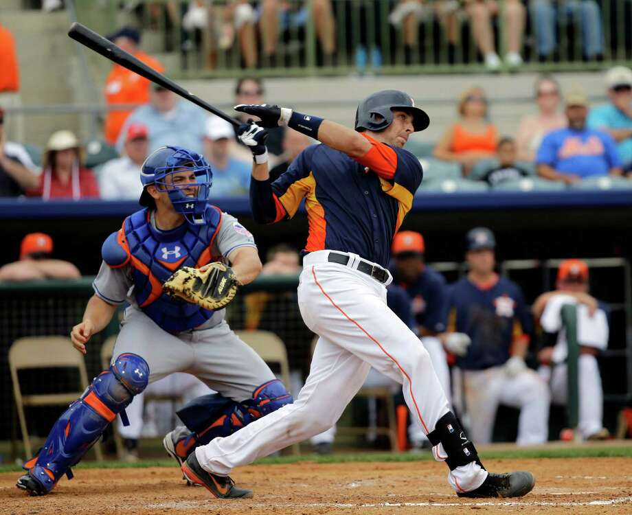 Houston Astros' Jason Castro, right, watches his two-run home run with New York Mets catcher Travis d'Arnaud, left, during the fourth inning of an exhibition spring training baseball game, Sunday, Feb. 24, 2013, in Kissimmee, Fla. (AP Photo/David J. Phillip) Photo: David J. Phillip, STF / AP